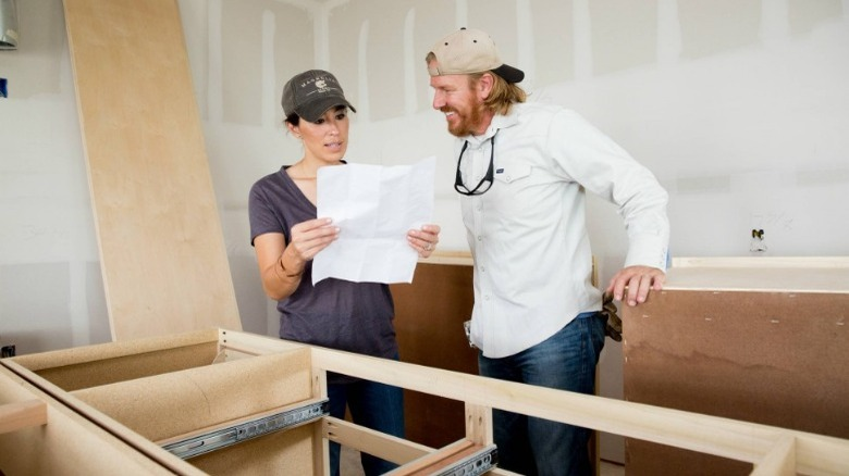 Chip and Joanna Gaines reviewing plans