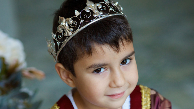 little boy dressed as a prince