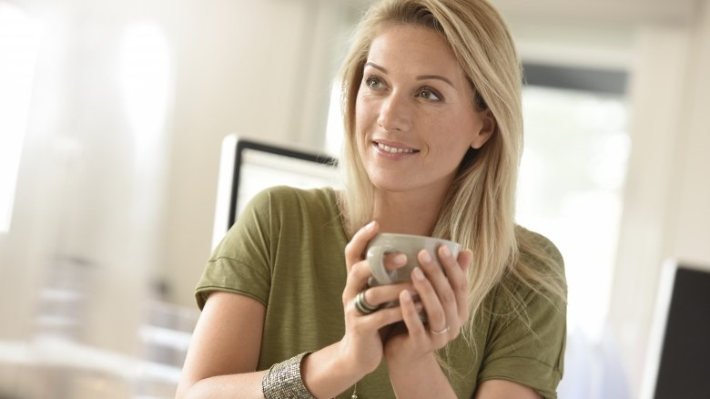 attractive mature woman holding coffee