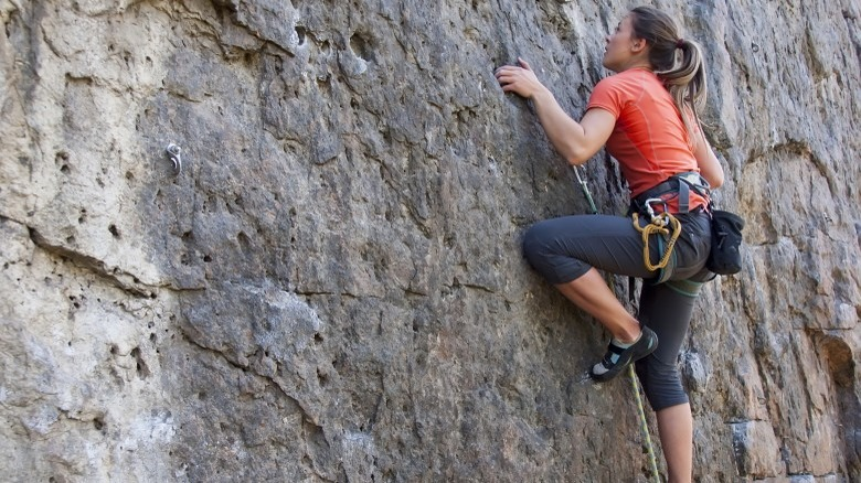 attractive woman rock climbing