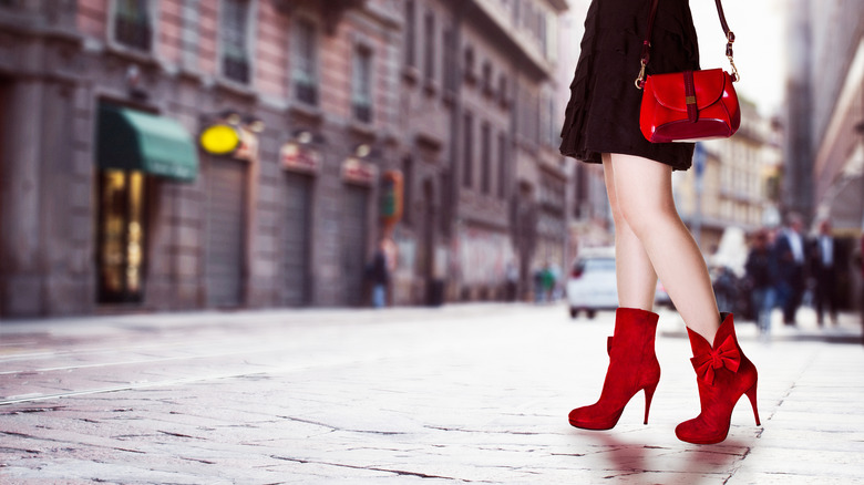 Woman wearing red heeled boots