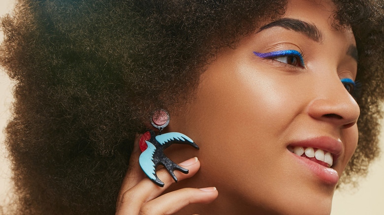 Woman with blue eyeliner