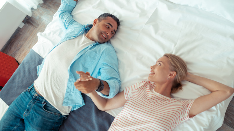 Holding hands while in sleep positions