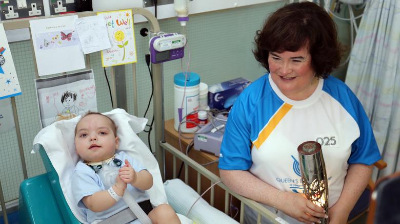 Susan Boyle with a baby