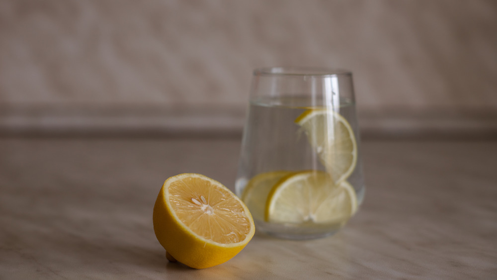 The Real Reason You Should Never Put A Lemon In Your Drink