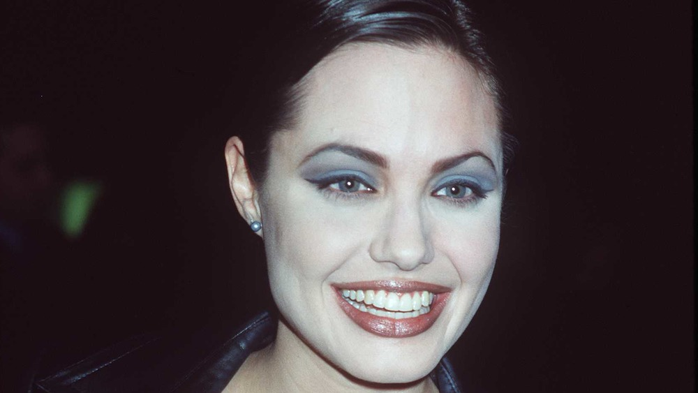 Angelina Jolie smiling in 1998, close-up
