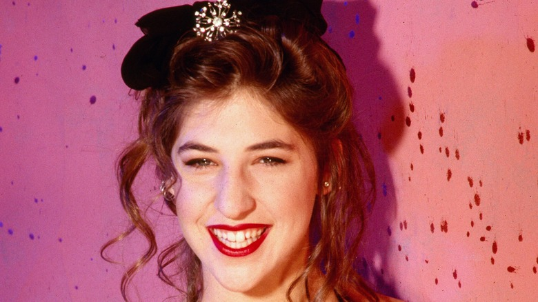 Mayim Bialik as a young woman with a bow on her head
