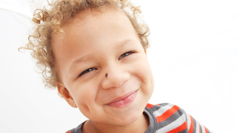 Young boy with dimples