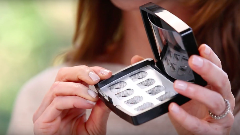 Katy Stoka, founder of One Two Lash, showing case