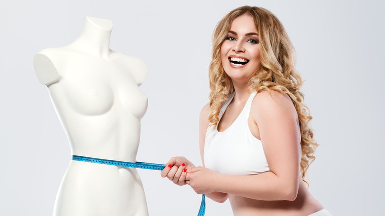 plus size woman with mannequin