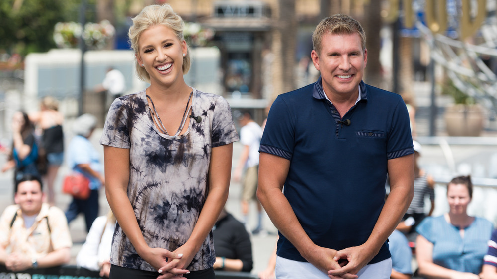 Todd and Savannah Chrisley in front of a crowd