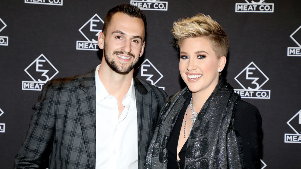 Savannah Chrisley and Nic Kerdiles, smiling