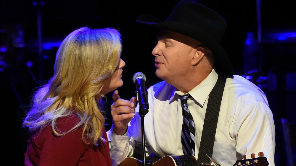Trisha Yearwood and Garth Brooks perform onstage during The Country Music Hall of Fame at the Country Music Hall of Fame in 2015