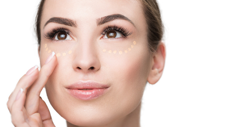 Woman with Maybelline concealer