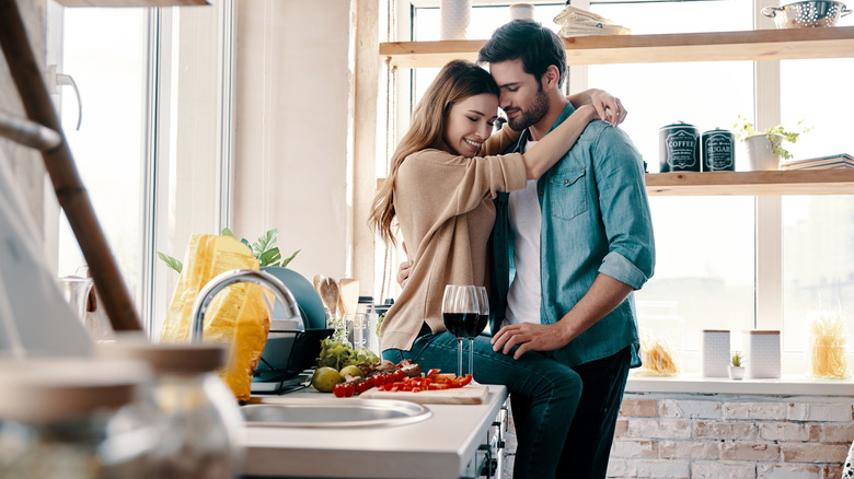 happy couple cooking before going to bed