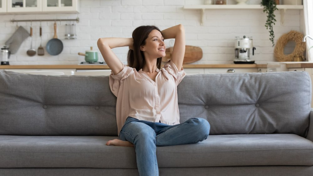 woman content on couch