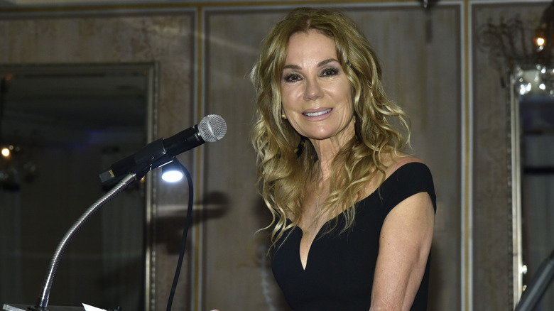 Kathie Lee Gifford standing at a podium