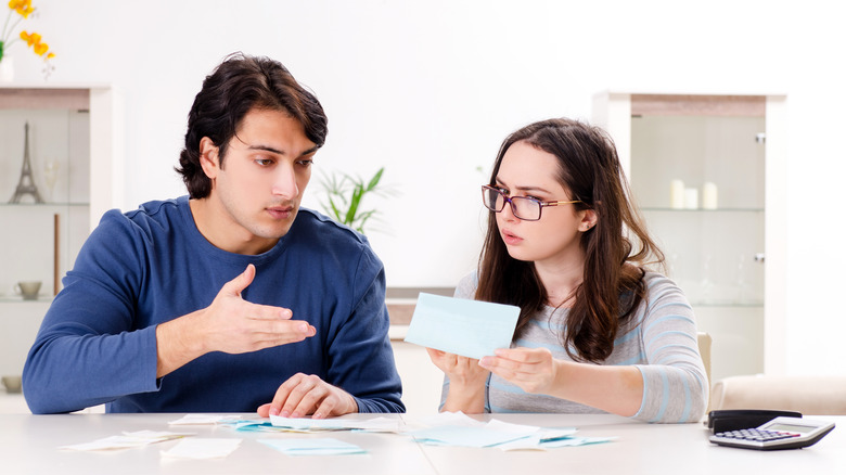 Couple planning a budget together