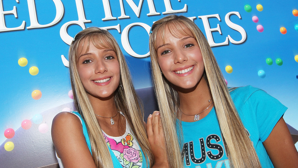 The Rosso twins wearing matching blue outfits