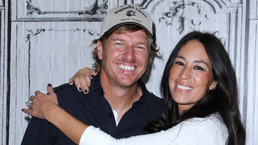 Joanna Gaines hugging Chip Gaines