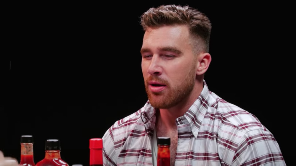 Travis Kelce unhappy on Hot Ones