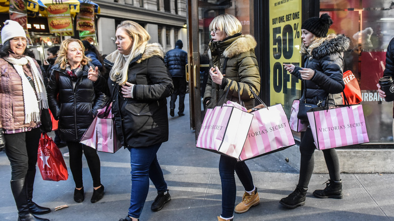 Shoppers carrying Victoria Secret Bags